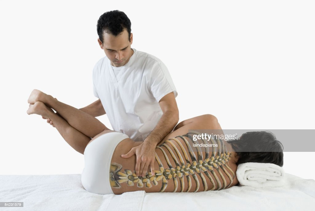 Chiropractor Adjusting Mans Back Stock Photo | Getty Images