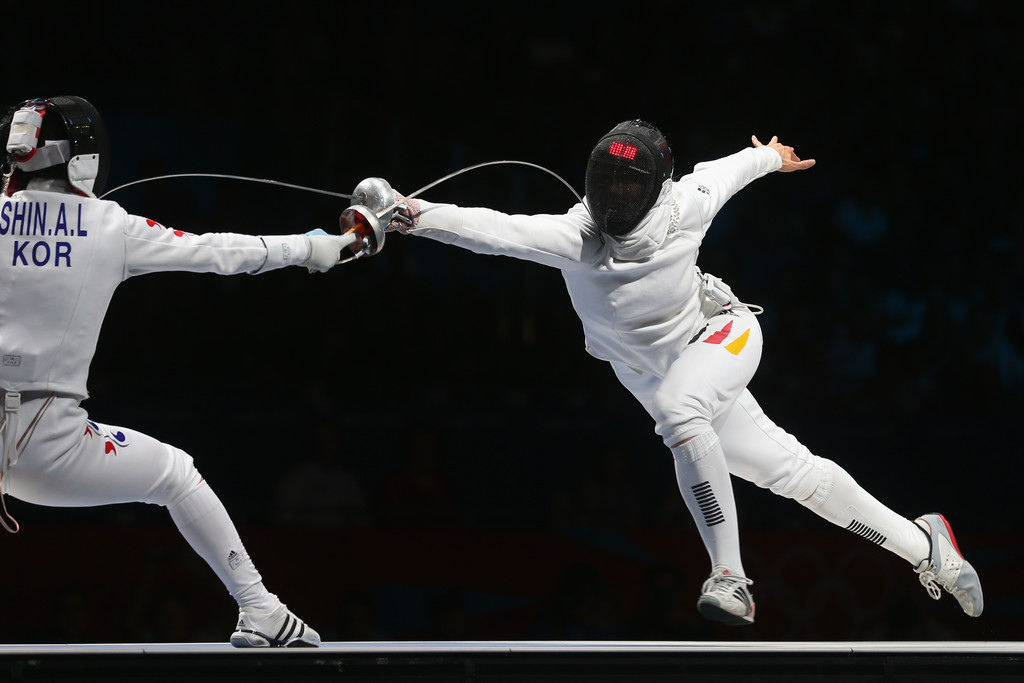 Britta Heidemann and Shin Lam Photos Photos - Olympics Day 3 - Fencing - Zimbio