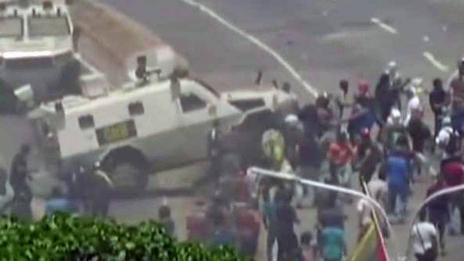 Venezuela uprising turns violent after military armored ...