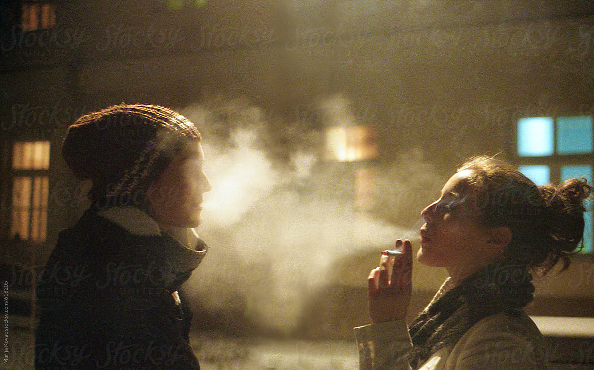 Two Girls Blowing Cigarette Smoke In Each Other Face ...