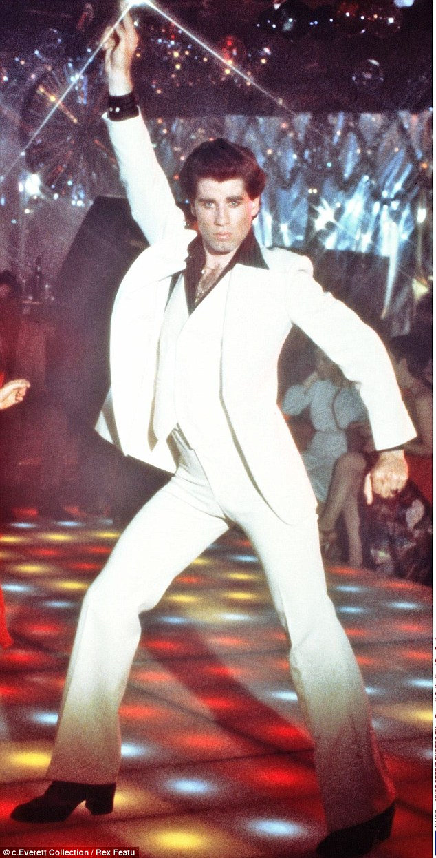 John Travolta looks positively giddy as he dances with ...