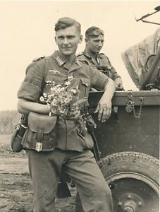WWII B&W Photo German Wehrmacht Soldier with Flowers World ...