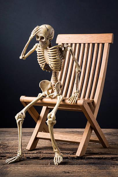 Royalty Free Photography Human Skeleton Sitting Chair ...