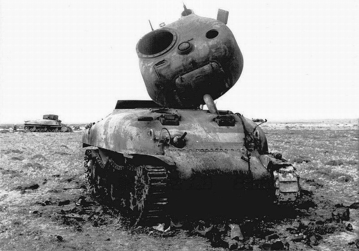 A Sherman tank destroyed by the German fire at the battle of Kasserine Pass. You can see the ...