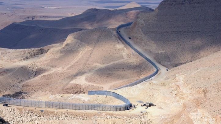 Israel raises height of fence on Egypt border | The Times ...