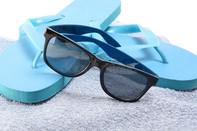 Flip Flops And Sunglasses On The Towel Royalty Free Stock ...