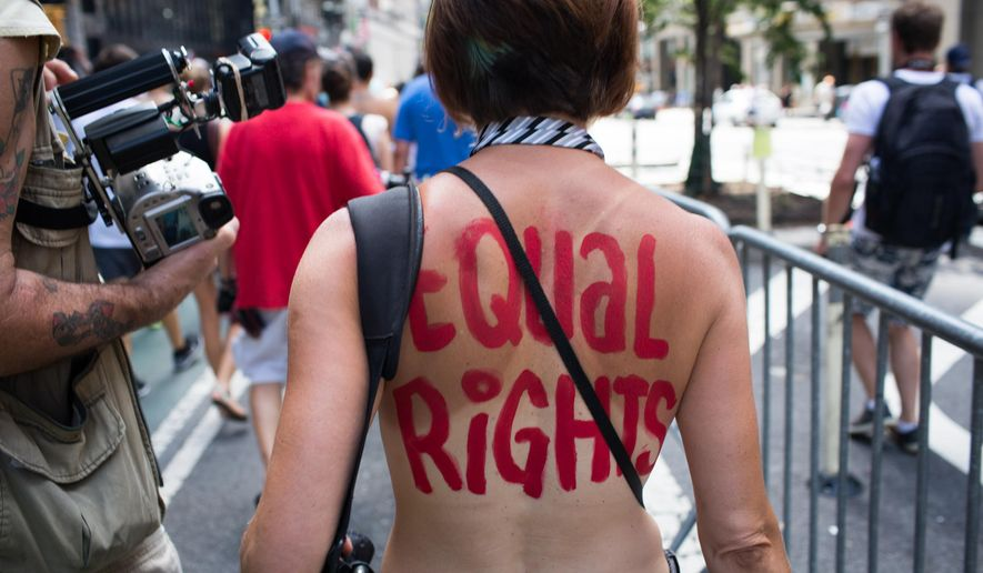 An activist marches in the protest march called the ...