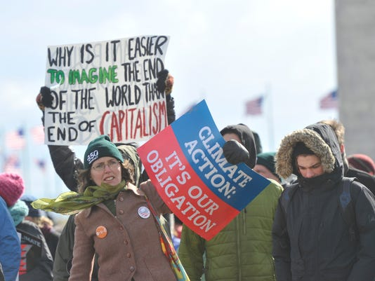Tens of thousands demand action on climate change
